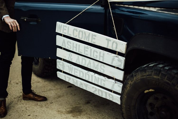 Wooden welcome sign for Oxfordshire barn wedding