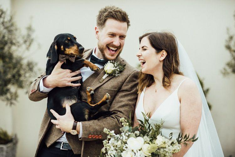 Couple have dachshund at Oxfordshire barn wedding