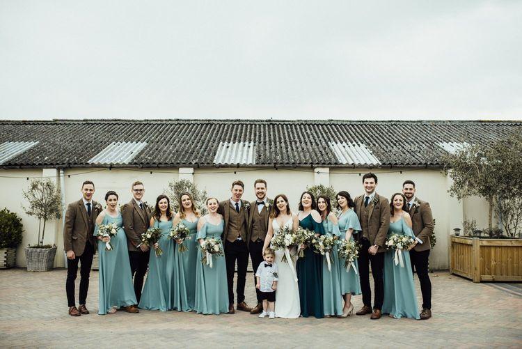 Blue Rewritten bridesmaid dresses with groomsmen in tweed suits