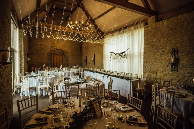 Oxfordshire barn wedding venue with fairy light canopy