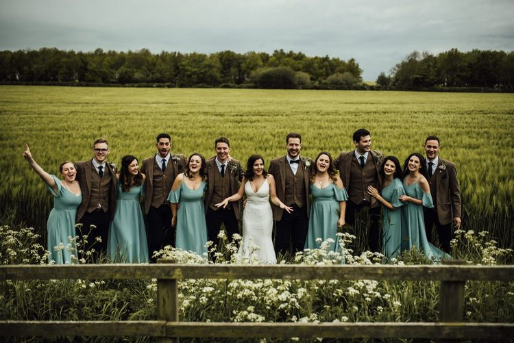Bridal party and groomsmen amongst Oxfordshire barn wedding venue grounds