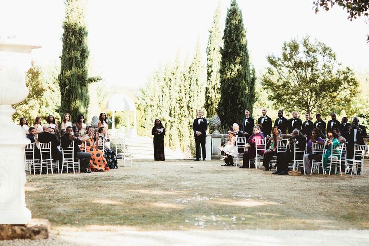 Chateau La Durantie outdoor wedding ceremony for destination wedding with pink bridesmaid dresses