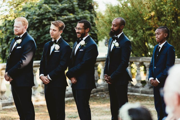 Groomsmen in Tuxedos at the outdoor wedding ceremony