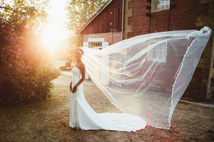Bride in strapless wedding dress and billowing veil