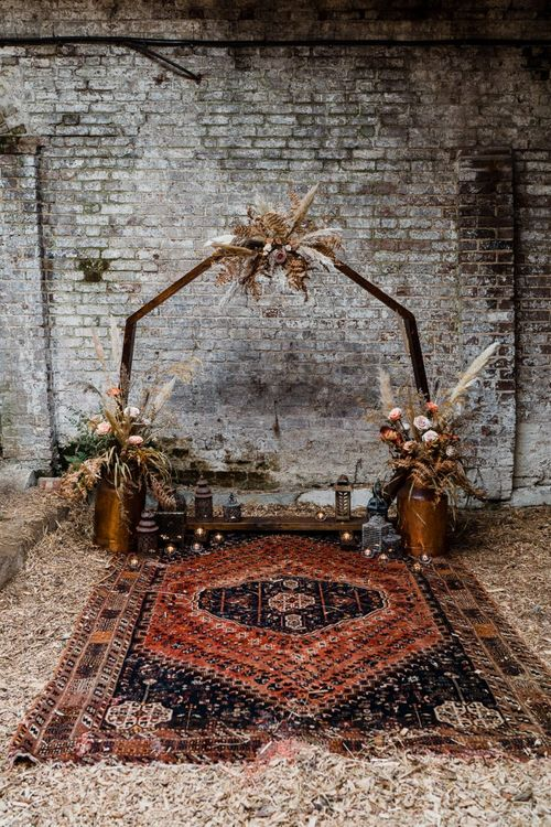 Wooden Frame Altar with Dried Flower Arrangements and Moroccan Rug