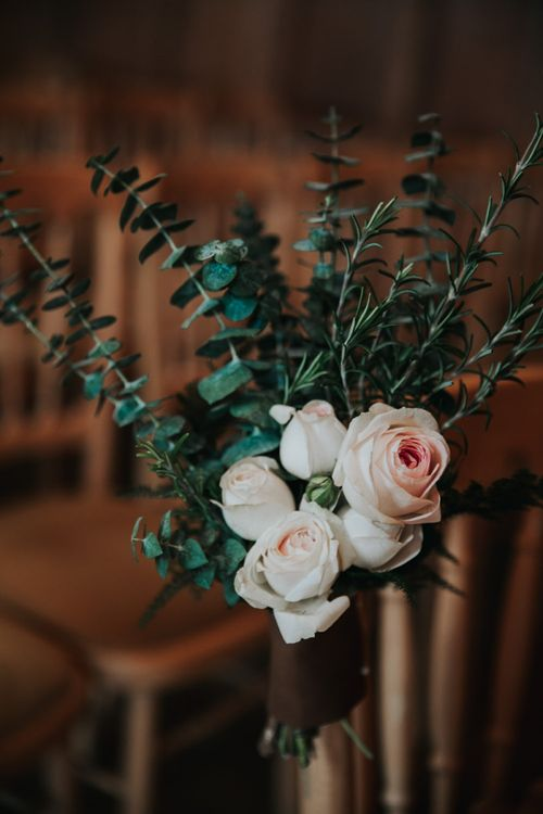 blush pink roses and eucalyptus aisle wedding flowers