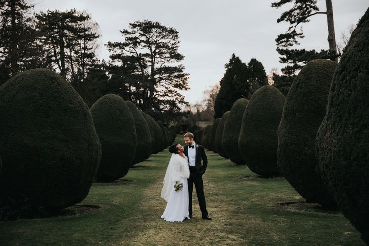 Bride and groom portrait in the gardens at The Elvetham wedding venue