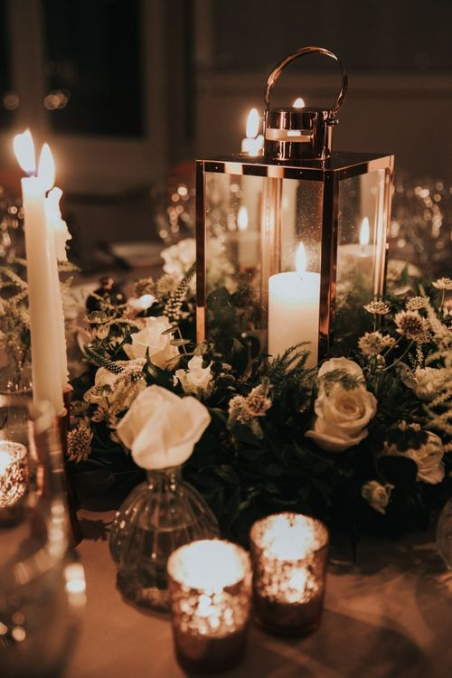 Table centrepiece with candles and flower arrangement
