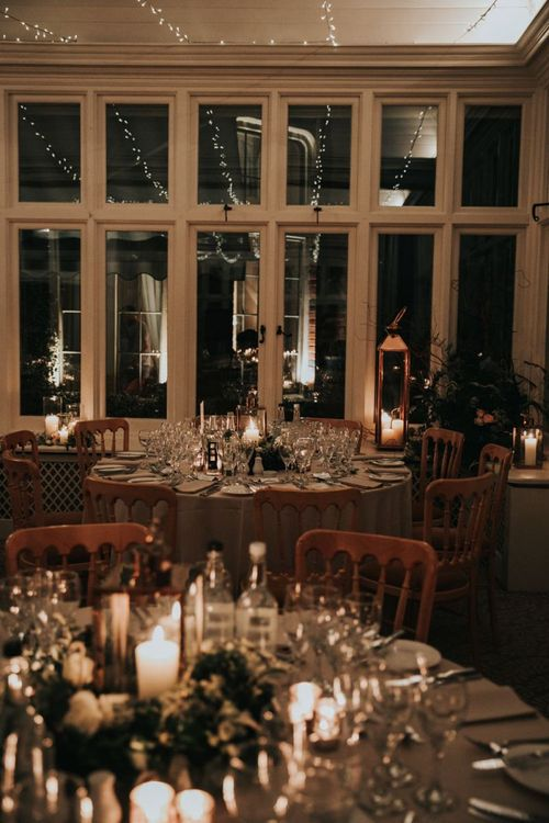 Romantic candlelight reception at The Elvetham wedding venue