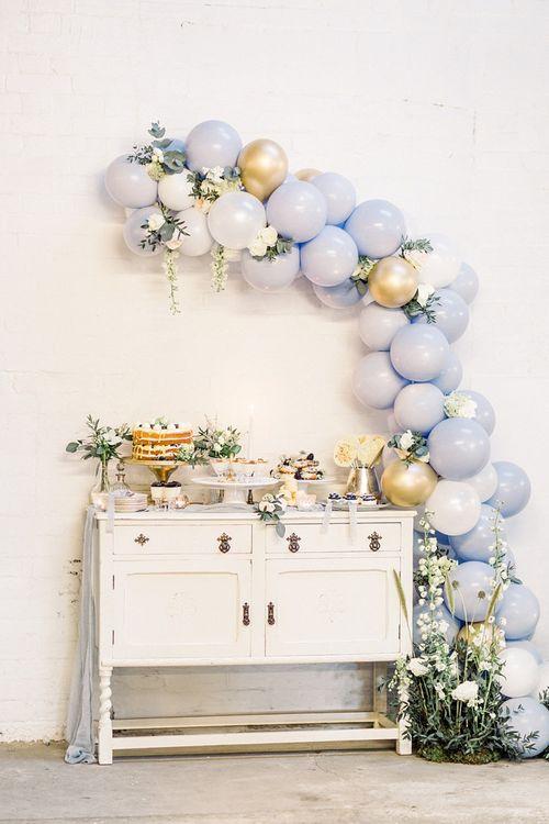 Vintage Dresser Dessert Table with Blue Balloon Arch Wedding Decor