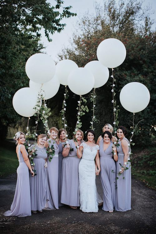 Bridal Party Holding Giant White Balloons with Ivy Vine String