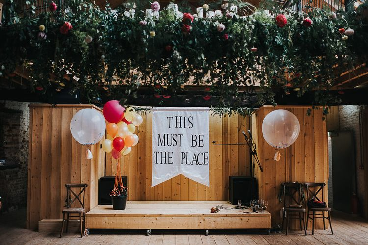 This Must Be The Place Stage Sign with Giant Balloons Wedding Decor