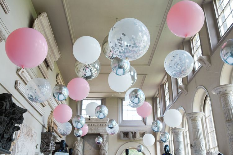 Pink, White and Clear Helium Filled Giant Balloons Lining the Ceiling