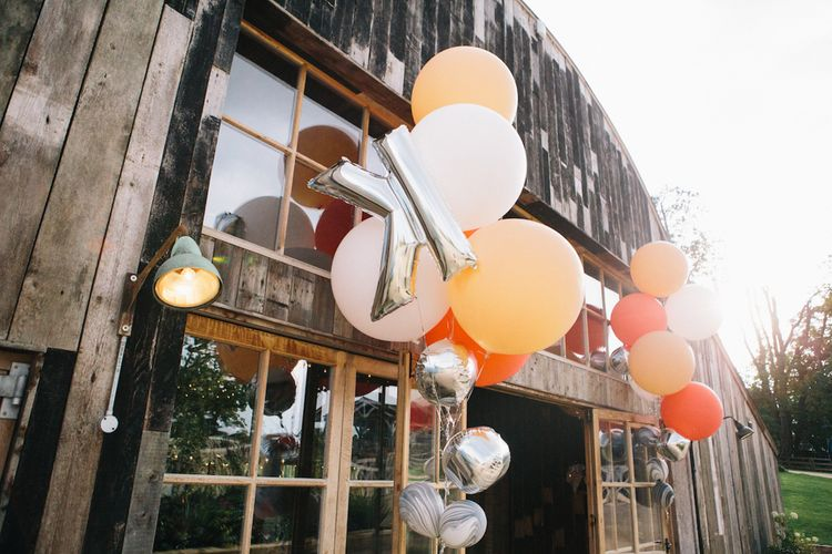 Coloured and Foil Balloons Decorating  the Entrance to the Wedding Venue