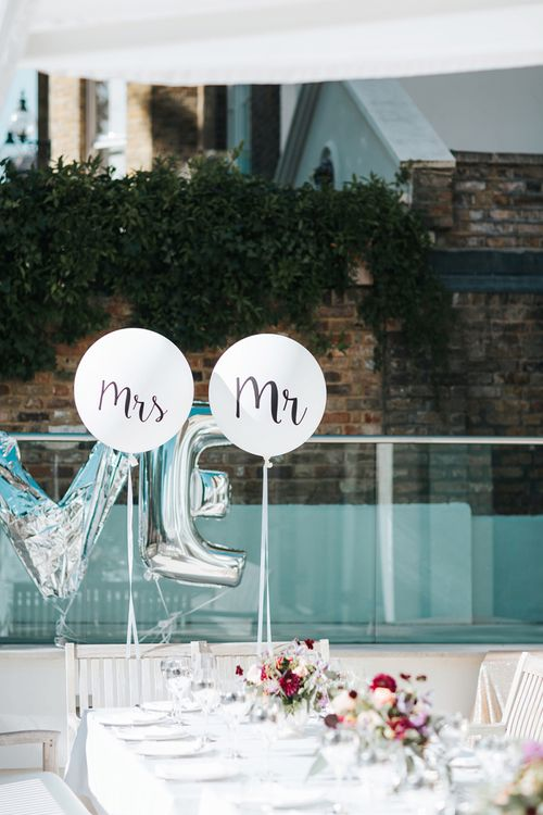 Mr & Mrs Slogan Balloons Tied To the Bride and Grooms Reception Chairs