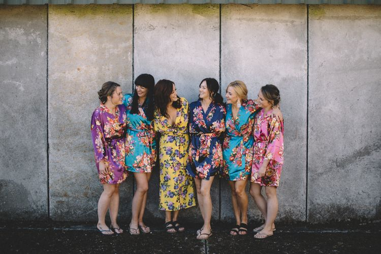 Bride In Bridesmaids In Floral Robe For Getting Ready // Image By Carrie Lavers Photography
