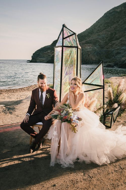 Festival bride and groom beach wedding ceremony