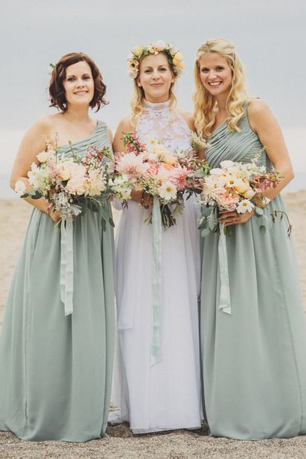 Bridesmaids in mint green dresses for coastal wedding
