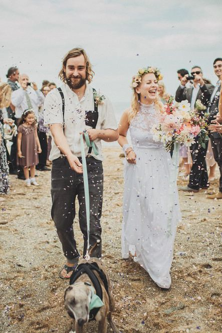 Confetti moment with pet dog at beach wedding