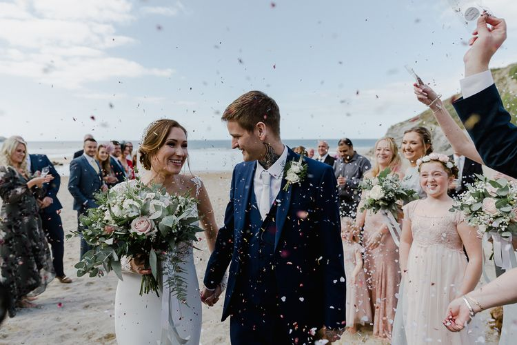 Confetti moment at Lusty Glaze beach wedding venue