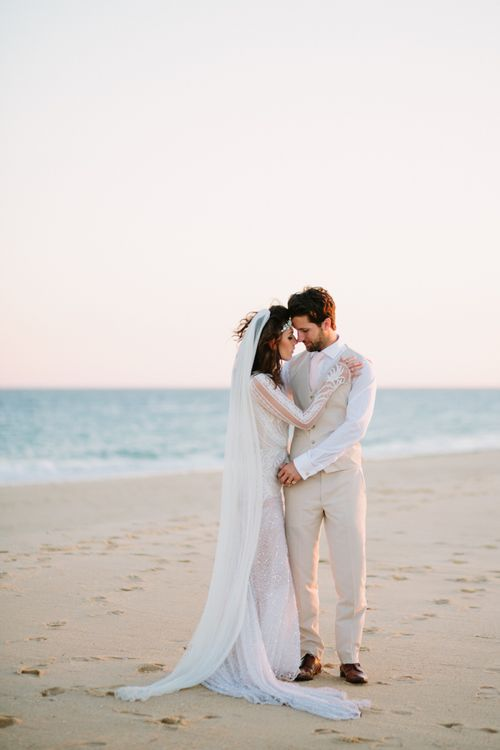Intimate bride and groom portrait on the beach