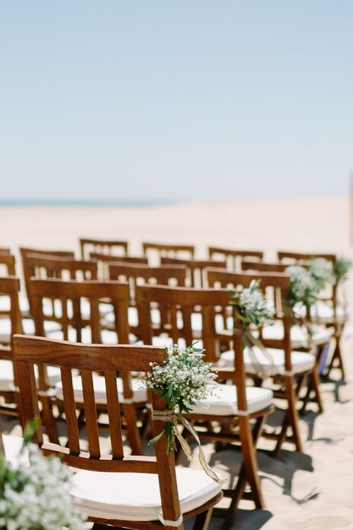 Beach wedding aisle chair flowers