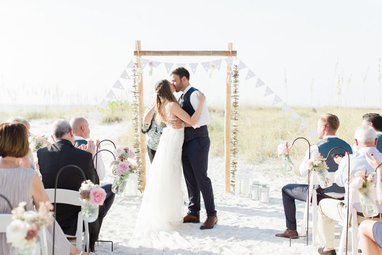 beach weddings ceremony with bunting decor