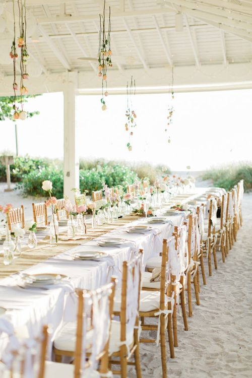 Beach weddings reception with hanging flowers