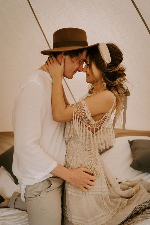 Boho Couple Embracing in a Bell Tent
