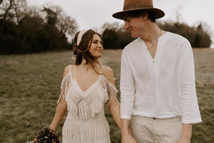 Boho Couple with Bride in Fringe Wedding Dress and Groom in Casual Shirt and Chino's