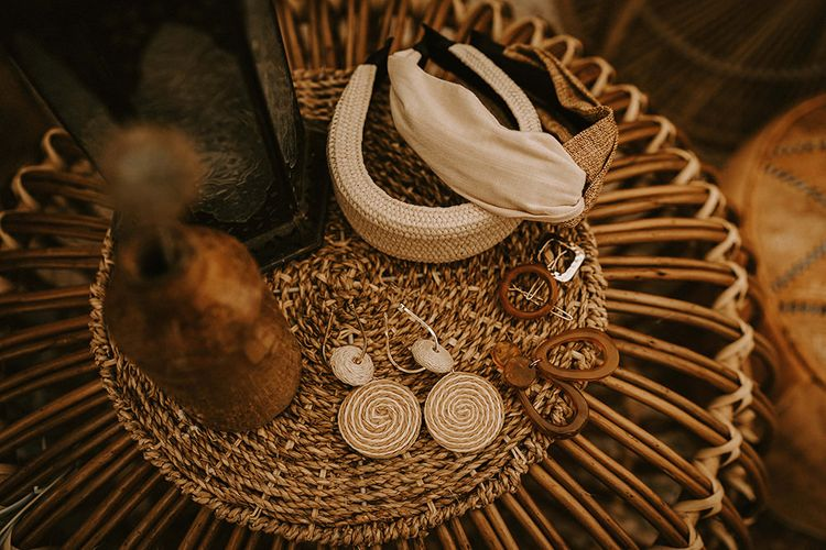 Bridal Accessories and Earrings on Wicker Table