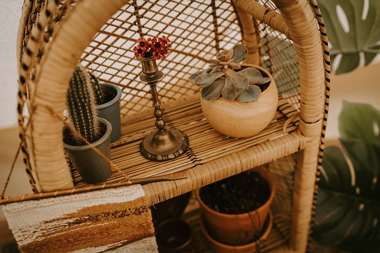 Wicker Shelving Unit with Cactus Plants, Succulents and Gold Candlestick