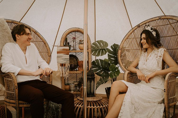 Boho Bride and Groom Relaxing in Peacock Chairs