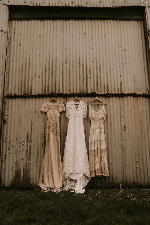 Three Boho Wedding Dresses hanging Up with Lace and Fringe Detail