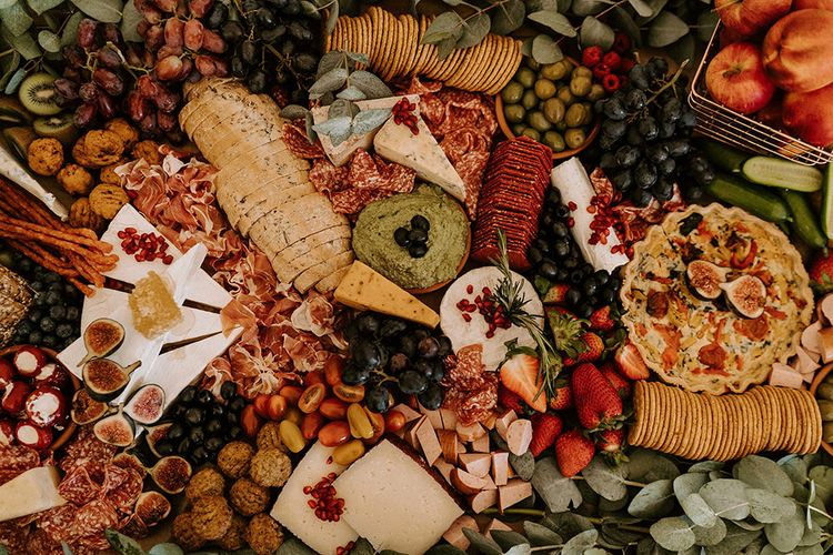 Grazing Board with a Mixture of Bread, Cheese, Crackers, Fruits and Vegetables