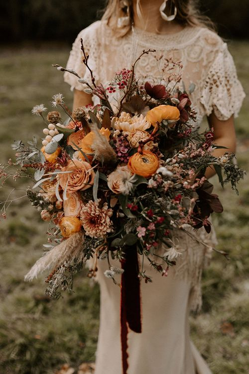 Boho Wedding Bouquet with Orange Flowers, Dried Grasses and Foliage