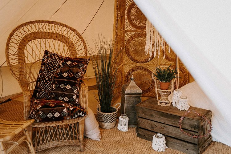 Wicker Chair and Moroccan Cushions for Relaxed Seating Area within w Bell Tent