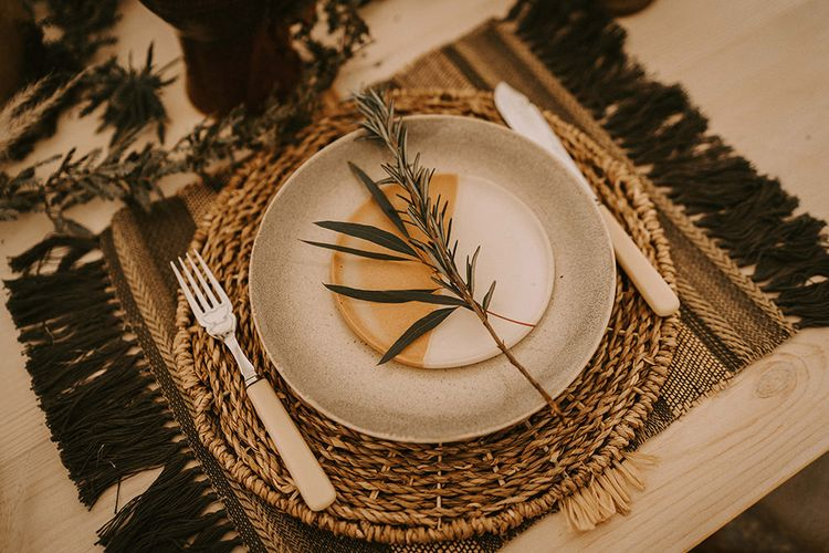 Place Setting with Ceramic Plate, Wicker Place Mat and Ivory Knife and Fork
