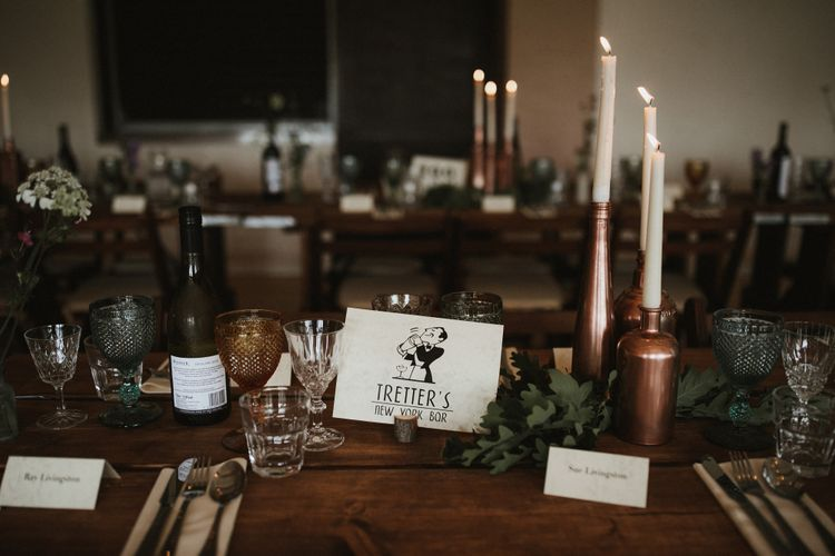 Wooden Trestle Tables With Copper Painted Bottles & Ivory Tapered Candles // James Frost Photography