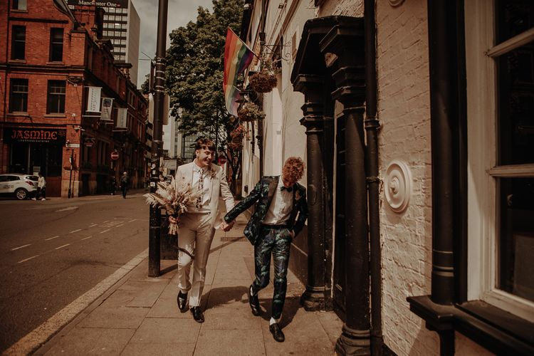 Gay couple in patterned and beige suits at Manchester elopement