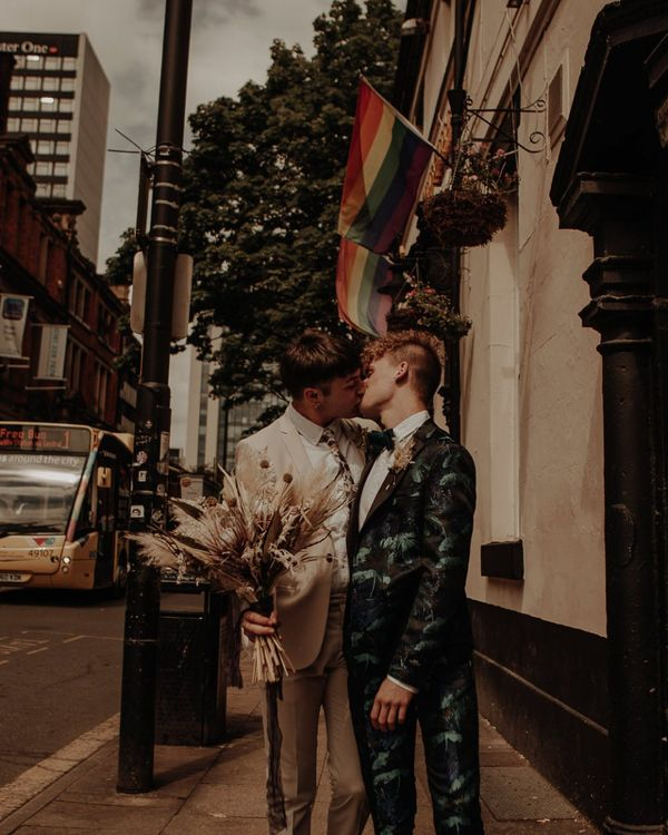 Grooms kissing at Manchester elopement wedding