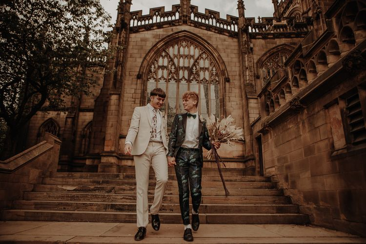 Two grooms walking down the church steps as husband and husband at Manchester elopement