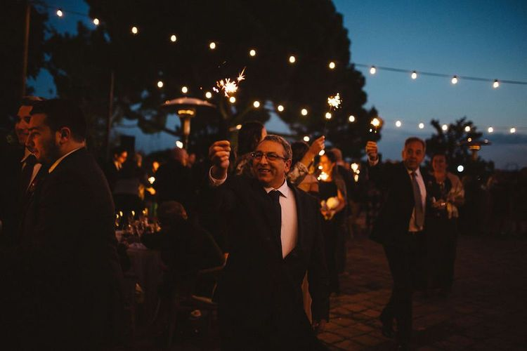 Wedding Guests Holding Sparklers