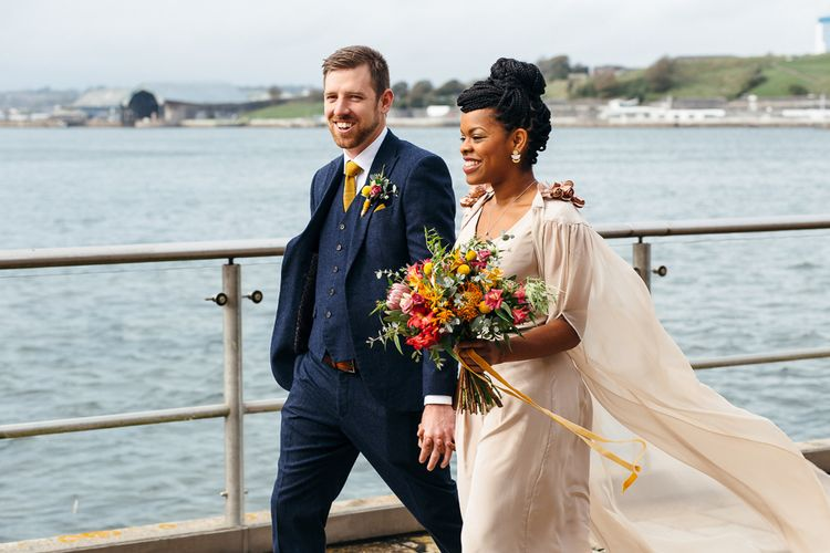 Black bride with braided top knot and wedding cape