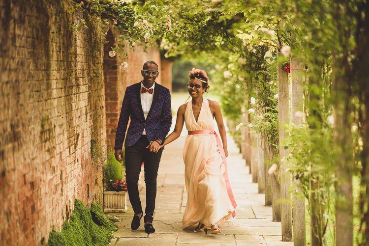Black bride in blush wedding dress and gold headdress