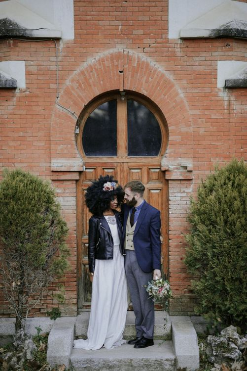 Stylish black bride with afro hair and leather jacket
