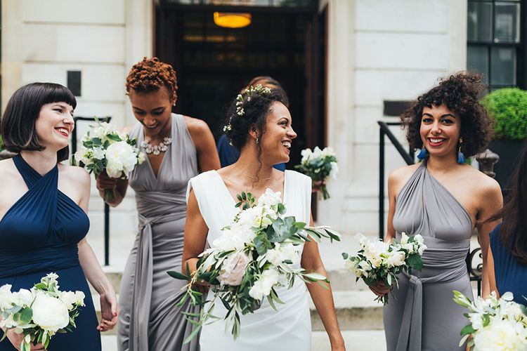 Black bride with flowers in her hair at city wedding