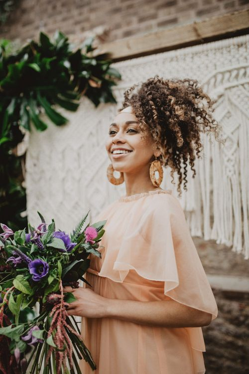 Black bride with curly hair tied in head scarf