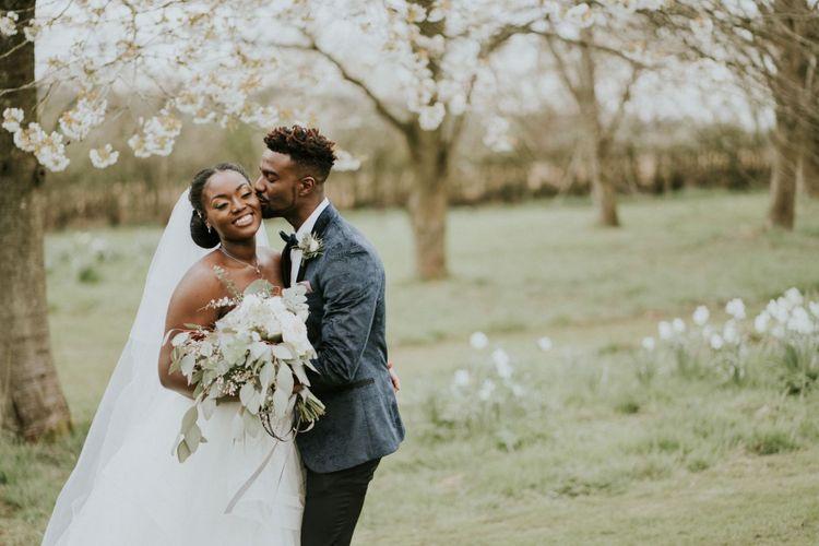 Black bride in off the shoulder wedding dress