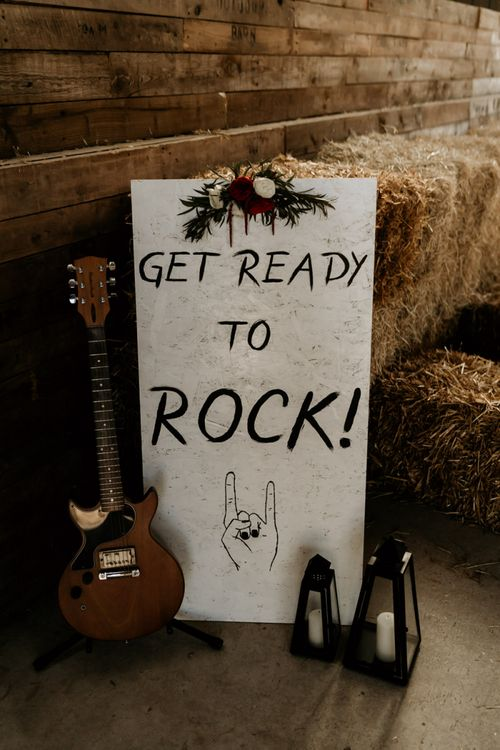 Get Ready to Rock Wedding Sign with Guitar and Hurricane Vase Decor